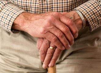 a senior leaning on a cane