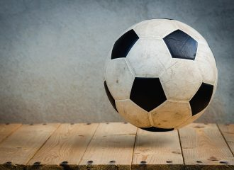 a soccer ball bouncing above the ground