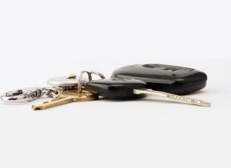 car keys laying on a white surface