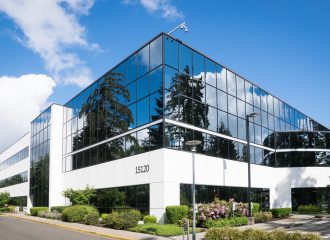 commercial business building with large glass windows