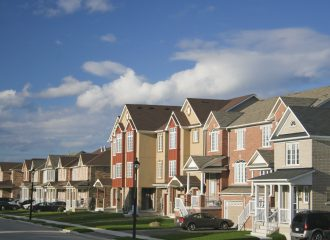 condos in a neighborhood with cars in the driveways