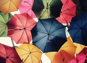 multicoloured umbrellas floating in the sky