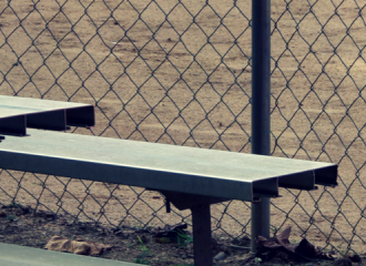 bleachers in front of a baseball field