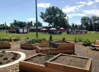 community garden with an event happening in the background