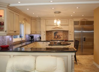 kitchen with stainless steel appliances, granite counter top, and chandelier