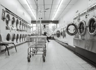 laundromat with a woman holding a laundry basket