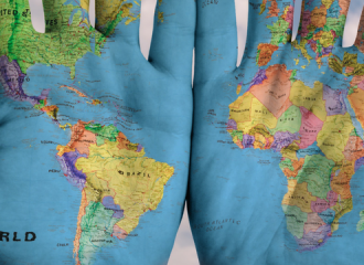 map of the world painted on hands