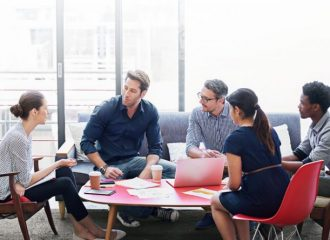people sitting at a table in a meeting