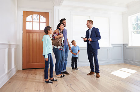 real estate agent showing house to a family