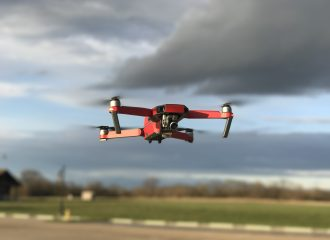 red drone hovering